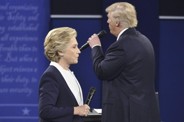 Les débats tout à fait inhabituels entre Hillary... (AFP, Paul J. Richards)