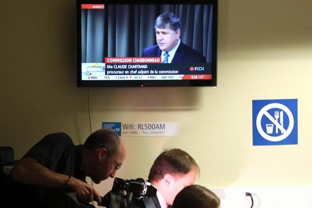 MeClaude Chartrand (qui apparaît dans la télévision) a... (Christinne Muschi, archives Reuters)