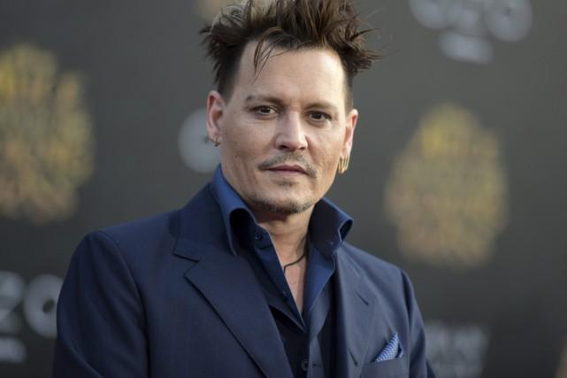 Johnny Depp fera son entrée dans le monde de la magie avec Les animaux... (PHOTO ARCHIVES AP)