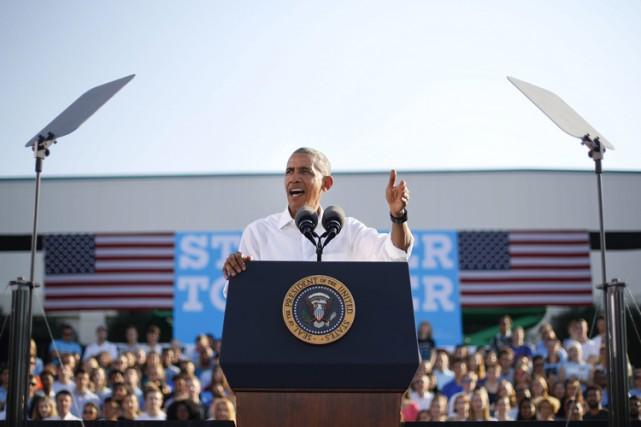 «Rejetez la peur! Choisissez l'espoir! Votez!», a lancé... (PHOTO AP)