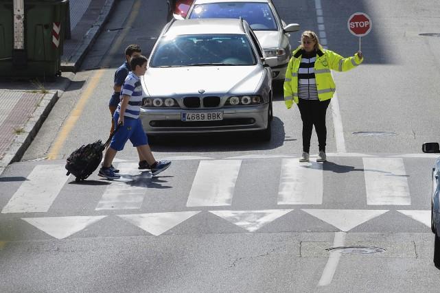 Les sacs d'école des étudiants espagnols seront moins... (AFP, Miguel Riopa)
