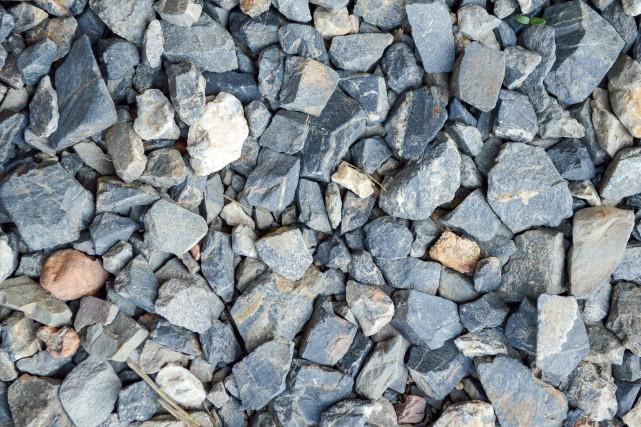 38777433 - granite stone in garden... (123RF)