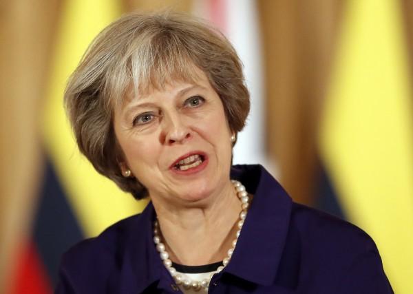 La première ministre Theresa May a déjà indiqué... (AP)