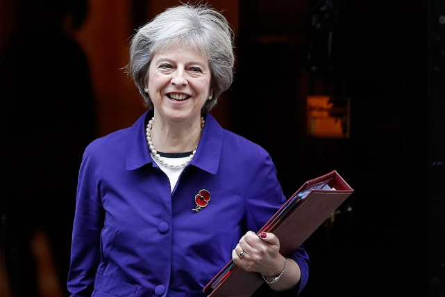 Theresa May, qui souhaite déclencher le Brexit avant fin... (Photo Kirsty Wigglesworth, AP)