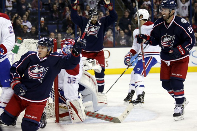 Nick Foligno, Cam Atkinson, Josh Anderson et Scott... (Paul Vernon, Associated Press)