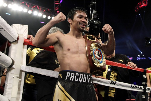 Manny Pacquiao... (PHOTO JOHN GURZINSKI, AGENCE FRANCE-PRESSE)