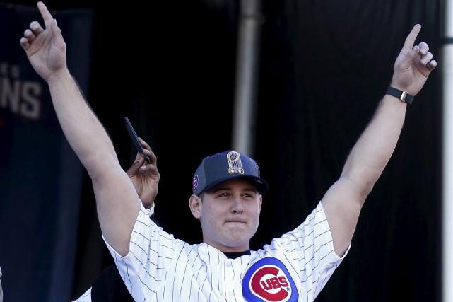 Le premier but Anthony Rizzo, lors des célébrations... (AP)