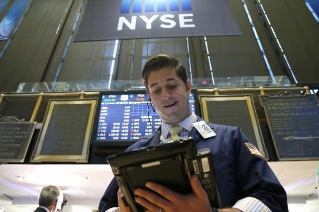 Wall Street a déjoué la plupart des pronostics mercredi en réagissant par une... (PHOTO REUTERS)