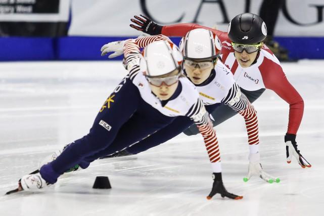 Valérie Maltais apparait à droite.... (Photo Presse Canadienne)