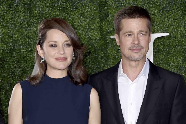 Marion Cotillard et Brad Pitt assistaient mercredi à... (AP, Jordan Strauss)
