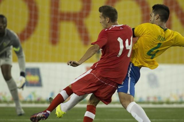 Louis Béland-Goyette (14)a disputé deux matchs avec l'équipe... (Photo Peter Power, PC)