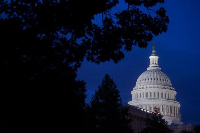 Les parlementaires américains devraient adopter vendredi soir une loi finançant... (PhotoAndrew Harrer, Blooberg)
