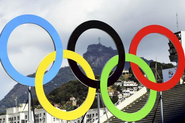 Plusieurs travailleurs étrangers lors des Jeux olympiques de... (Photothèque Le Soleil)
