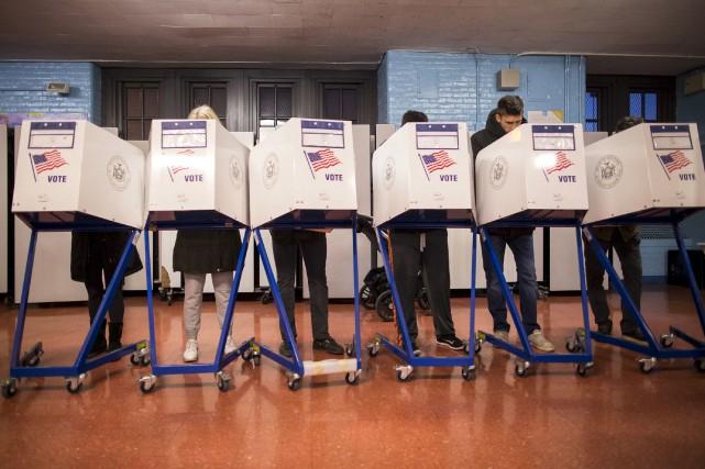 Aux États-Unis, c'est le nombre de grands électeurs,... (Photo archives AP, Alexander F. Yuan)