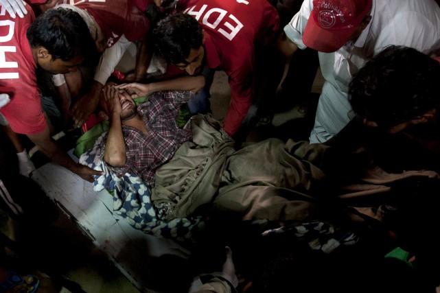Cette attaque a été revendiquée par le groupe... (PHOTO Shakil Adil, AP)