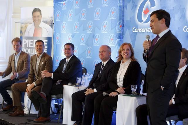 De gauche à droite: Chris Alexander, Maxime Bernier,... (Photo archives La Presse Canadienne)