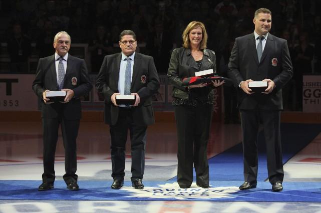 Rogatien Vachon, Sergei Makarov, Kalli Quinn représentant Pat... (Agence France-Presse)