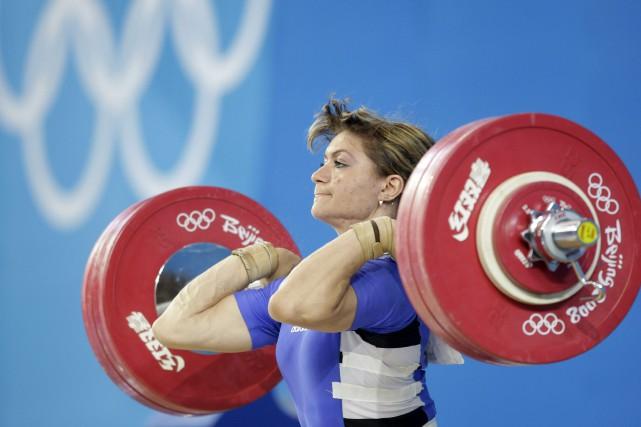 L'haltérophile kazakheIrina Nekrasova va perdre sa médaille d'argent... (archives AP)
