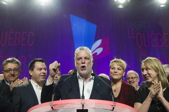 Le premier ministre Couillard nous promet tardivement un... (La Presse Canadienne)