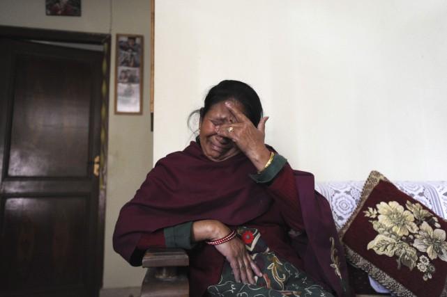 Les yeux de Sabitri Chilwal s'emplissent de larmes... (AFP)