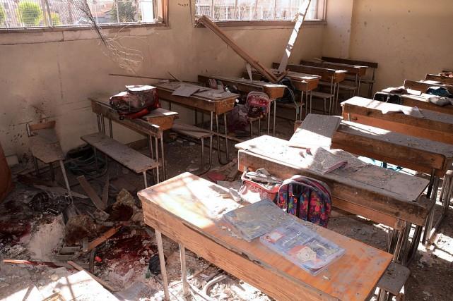 La violence des bombardements a également contraint les... (PHOTO GEORGE OURFALIAN, AFP)