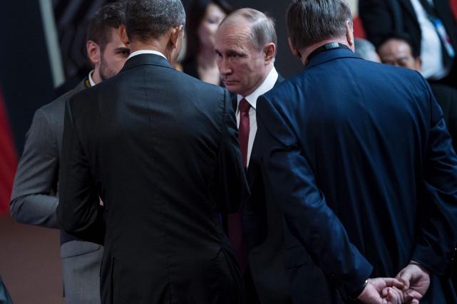Barack Obama et Vladimir Poutine ont échangé quelques... (PHOTO Brendan Smialowski, AFP)