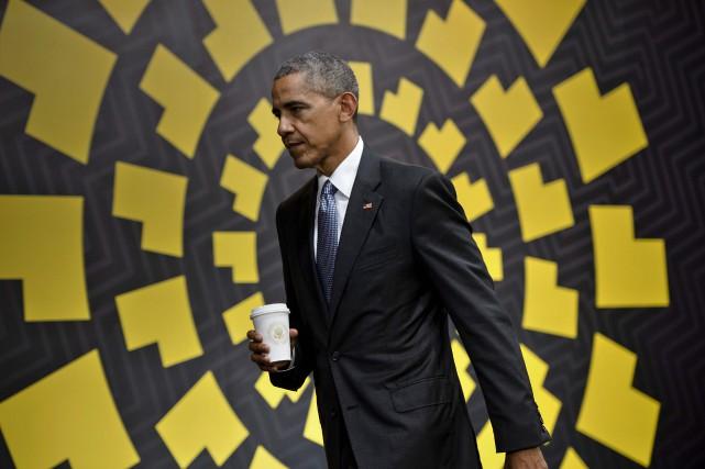 M. Obama a dit ainsi vouloir s'inscrire dans... (Photo AFP)