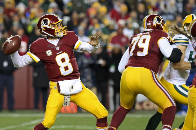 Kirk Cousins (8) a lancé trois passes de touché... (Photo Geoff Burke, USA Today Sports)