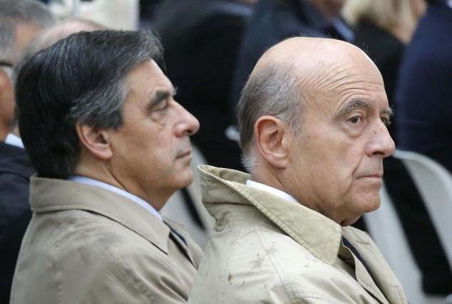Francois Fillon et Alain Juppé, candidats au premier... (AP)