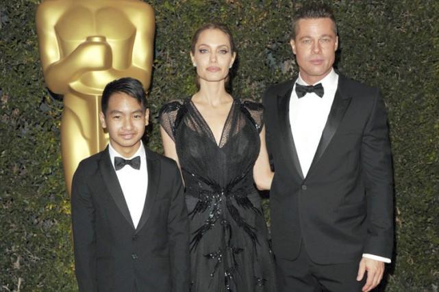 Brad Pitt est accompagné de son fils Maddox... (Archives AP)