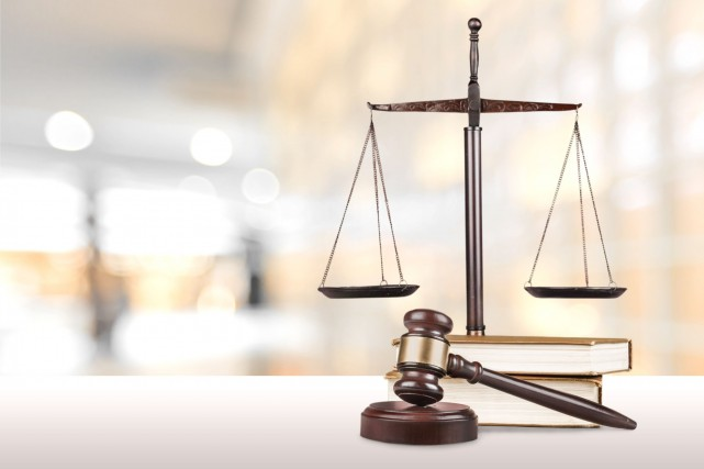 OPINION / Les avocats et notaires de l'État québécois oeuvrent comme légistes... (PHOTO ARCHIVES)