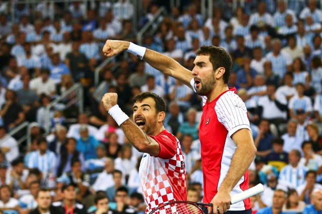 Ivan Dodig et Marin Cilic... (PHOTO Antonio Bronic, REUTERS)