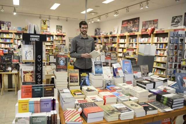 Maximilien Bouchard, propriétaire de la librairie Marie-Laura mise... (Photo Le Progrès-Dimanche, Jeannot Lévesque)