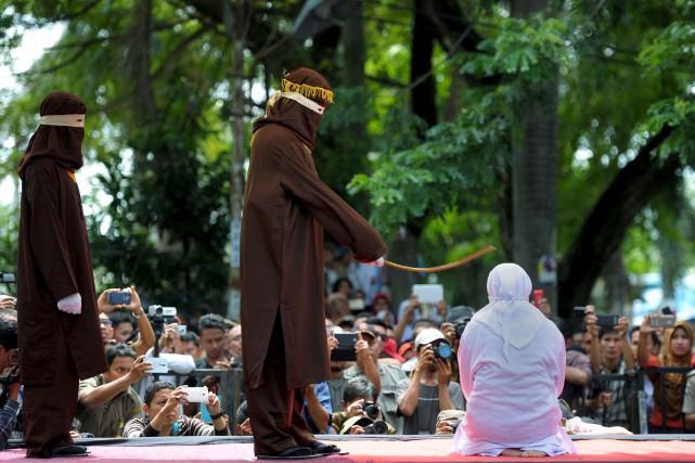 À Banda Aceh en Indonésie, une femme, âgée... (AFP, Chaideer Mahyuddin)