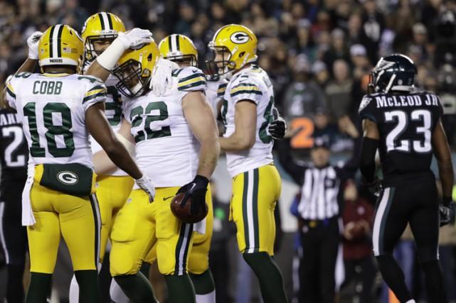 Aaron Rodgers a lancé deux passes de touché à Davante Adams et les Packers de... (PHOTO AP)