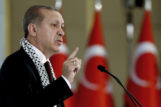 Turkey's President Recep Tayyip Erdogan addresses a parliamentary... (AP)