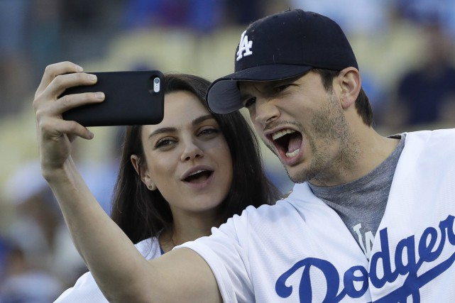 Ashton Kutcher, 38 ans, et Mila Kunis, 33... (PHOTO David J. Phillip, ARCHIVES AP)
