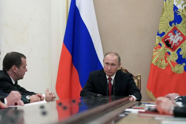 Vladimir Poutine a pris la parole devant une... (AP)