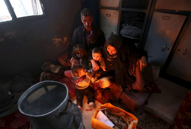 Jomaa al-Qassem, avec sa conjointe, sa fille et... (AFP)