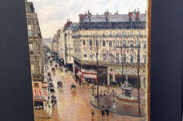 Rue Saint-Honoré, dans l'après-midi. Effet pluie, de Camille... (PHOTO AP)