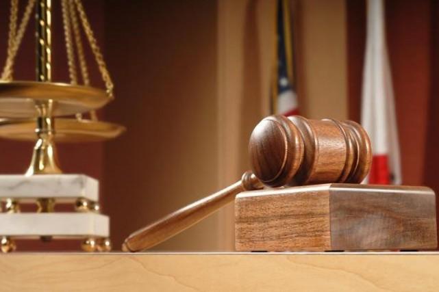 En attendant de réformer le système judiciaire, plutôt... (AP)
