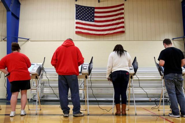 Les Noirs sont supposés voter très majoritairement pour... (PHOTO REUTERS)