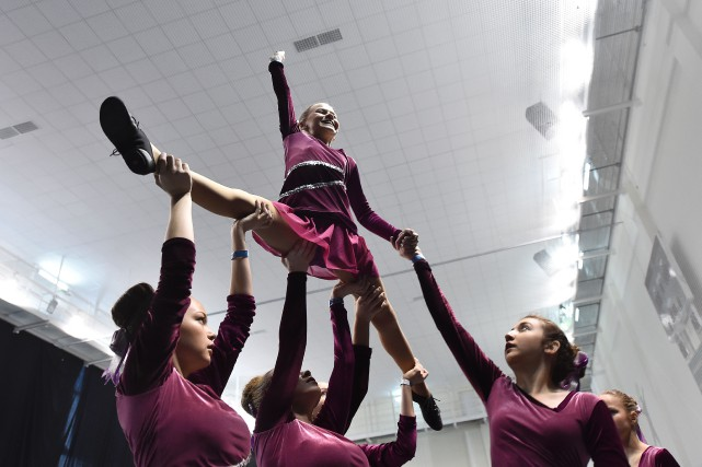 Une équipe de cheerleading au Championnat de cheerleading... (Photo Natalia Kolesnikova, archives Agence France-Presse)