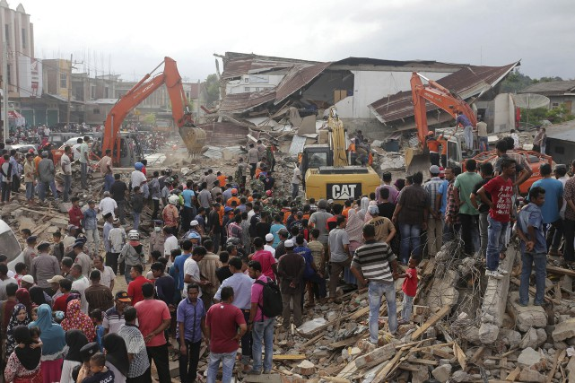 «Jusqu'ici, 97 personnes ont été tuées et le... (AP)