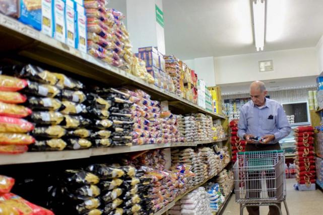«La sensibilité des consommateurs face aux prix a... (PHOTO FEDERICO PARRA, ARCHIVES AGENCE FRANCE-PRESSE)
