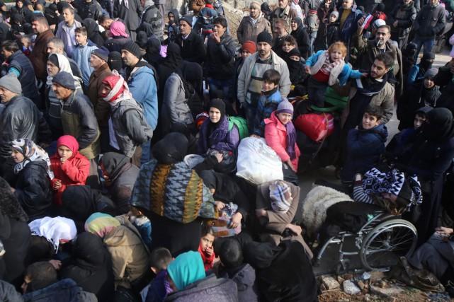 L'armée syrienne a interrompu ses opérations de combat... (photo Youssef KARWASHAN, Agence France-Presse)