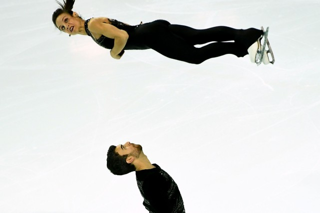 Meagan Duhamel et Eric Radford... (Photo Anne-Christine Poujoulat, AFP)