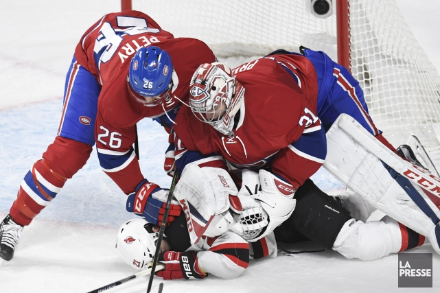 Carey Price et Jeff Petry s'attaquent à Kyle... (PHOTO BERNARD BRAULT, LA PRESSE)
