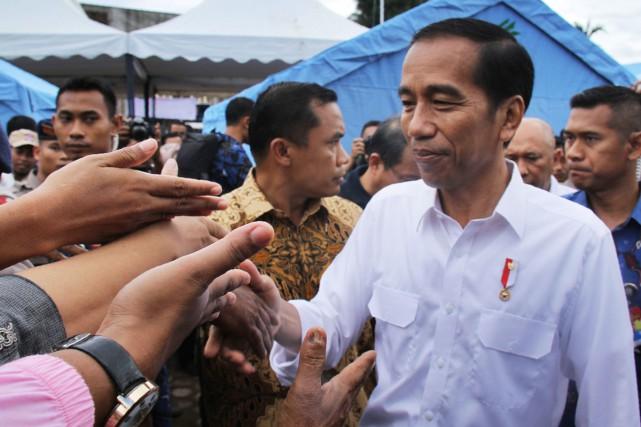 Le président indonésien, Joko Widodo, en visite sur... (PHOTO AFP)