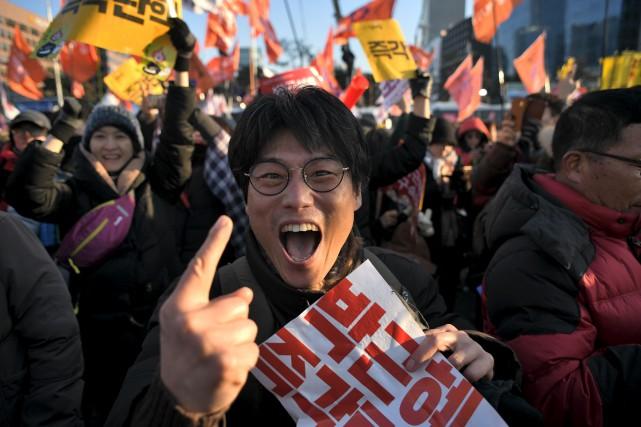 L'issue du vote parlementaire a été accueillie par... (AFP)
